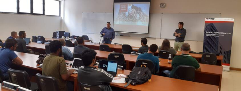 IT professionals giving presentation to university students in classroom