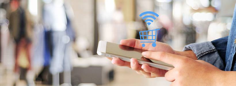 online shopper using smartphone for purchase, floating shopping cart