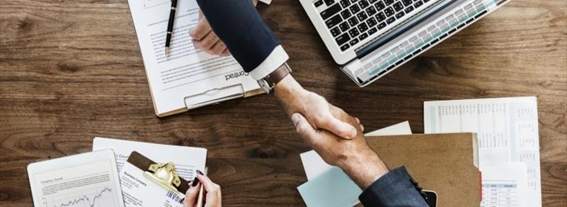 business person making agreement, shaking hands, contract, laptop