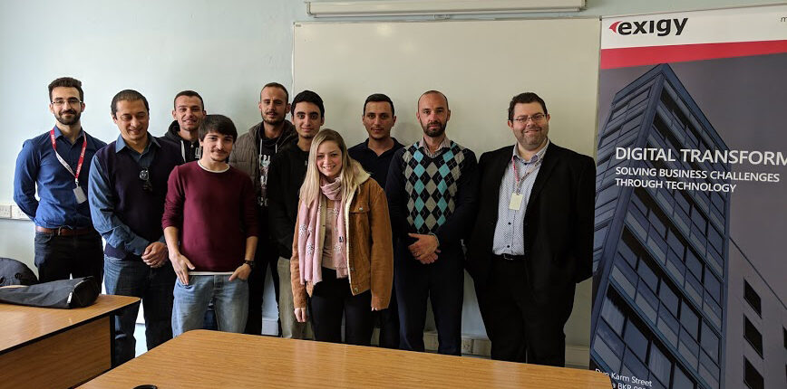 group of students taking photo with ceo in a classroom